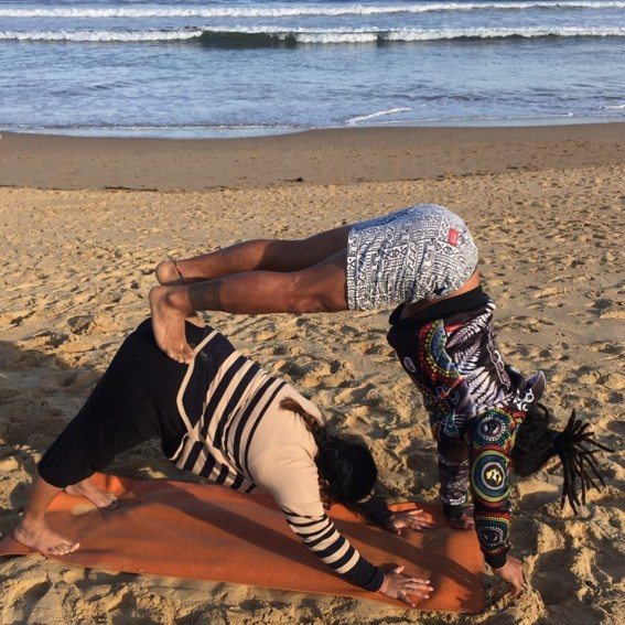 acroyoga beach downward dog adjustment