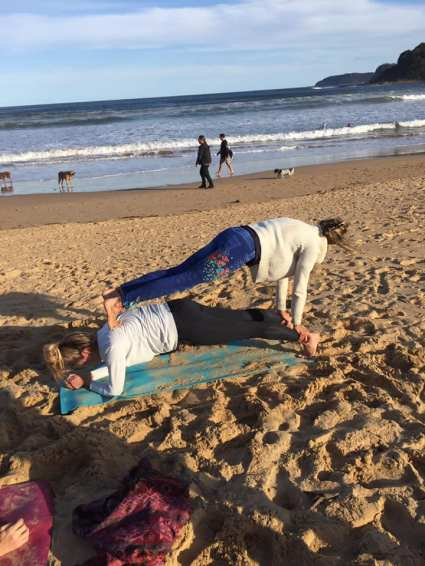 Beach acro yoga planks